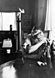 Dean. Loving his cat. Through the lens of Sanford Roth.