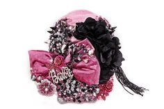 This Pink cotton hat has a Barbie-Pink metallic Panne' velvet bow with a Pink crystallized Barbie medallion in the middle, a detachable crystal veil, a large Multi-Pink crystal flower, a Black jet-bead tassel, and it's all hand beaded with Swarovski crystals, Black/Silver embroidered sequined flowers, Fushcia Pink sequined floral appliques', Black and Silver metal spikes, large Iridescent, Black, Pink, and Clear jewels, Black laser-cut satin flowers, and Pink Swarovski crystal beads...