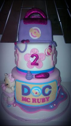 three tiered doc mcstuffin lambie girls birthday cake - Awe! Getting this for baby girl's 2nd b-day! <3 she LOVES Lambie!!