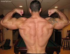 a huge back muscles lats delts hunky stud