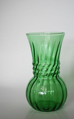 Vintage Anchor Hocking Green Swirl Optic by LittleShopTreasures, $9.99    I am not a green fan but I have to say I admire this vintage clear green vase. I picture it on a window sill in a grouping and the sunlight peering through. Lovely.
