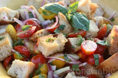 Panzanella Salad - need - white balsamic vinegar - garlic cloves - fresh parsley - fresh basil - cucumber - 2 boxes of assorted tomatoes - red grape and yellow pear tomatoes - herbs de Provence - olive oil - garlic salt - 1 loaf dense bread - something like a Rosemary Tuscan Bread -