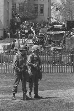 Burned out ROTC building, two National Guard personnel in foreground. May 3, 1970