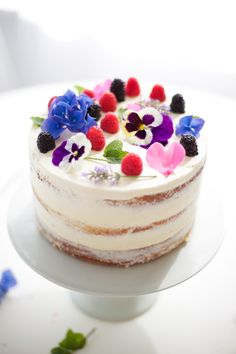 fruity pretty flowery naked cake with flowers - coco cake land