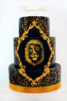 gold and black cake with lion
