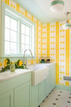 To help this laundry room feel bright, cheerful, and lively, the designers at Interieurs paired colorful yellow wallpaper with jadite accents and timeless schoolhouse lighting. Photo courtesy of Interieurs and Jane Beiles Retro Industrial, Yellow Laundry Rooms, Do It Yourself Design, Green Cabinets, Yellow Kitchen Cabinets, Yellow Kitchen Paint, Bright Kitchen Colors, Bright Colors, Yellow Kitchens