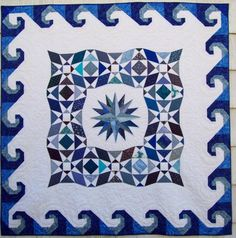 """""""Memories of the Titanic"""" by Pamela Quilts, a Storm at Sea quilt with Snail's Trail border.  Seen at Design Style Guide: Art That Keeps You Warm"""