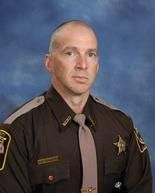 Gunfire took the life of Deputy Scott Ward, 47. Ward was pronounced dead after he was taken by helicopter to the University of South Alabama Medical Center.