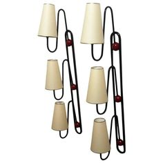 """Jean Royère Documented Pair of Three-Light Red and Black Sconces Model """"Boule""""   From a unique collection of antique and modern wall lights and sconces at https://www.1stdibs.com/furniture/lighting/sconces-wall-lights/"""