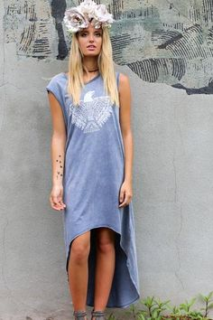 Trendy slate slight acid wash tank dress. Urban Rebel features a hi-low hem with a graphic print. Material is Cotton and Polyester Model Emme is 5'9 wearing siz