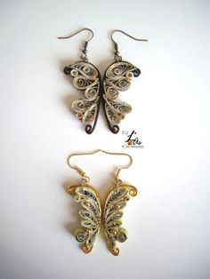 papillons en quilling by L¨As Créations http://lascreation.over-blog.com/article-boucles-d-oreilles-quilling-papillon-122508099.html