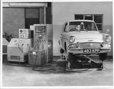 Peter Challis's Ford Anglia (Pompadour Blue, white wall tyres) on Mike Wilkey's R&I vibration platform, 1962 Ford Motor Company, Ford Anglia, Automotive Art, Station Wagon, Old Photos, Classic Cars, The Past, Platform, History