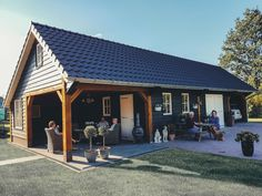 A beautifully decorated wooden patio with canopy, Wooden Patios, Pavilion Design, Cabin Homes, Garages, Canopy, Tiny House, Garden Design, Pergola, Cottage