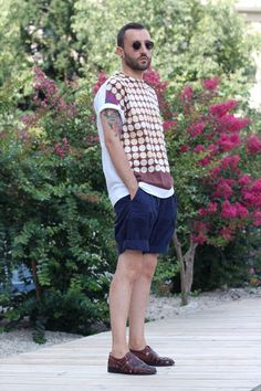 Pair a burgundy geometric crew-neck t-shirt and navy shorts to get a laid-back yet stylish look. Dress it down with burgundy leather sandals.  Shop this look for $101:  http://lookastic.com/men/looks/black-sunglasses-and-navy-shorts-and-burgundy-sandals-and-burgundy-crew-neck-t-shirt/3837  — Black Sunglasses  — Navy Shorts  — Burgundy Leather Sandals  — Burgundy Geometric Crew-neck T-shirt