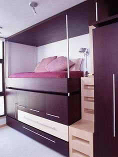 Lofted Hideaway  Fill the abundant cubic feet under a lofted bed with cabinets and drawers on extending rails. The bottom drawer contains a trundle bed.