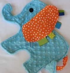 baby taggie toy from #agirlandagluegun I made one very similar to this with my own pattern and it turned out only okay. I think my trouble came with the fact that I tried to make my whole elephant too small. Aug. 2013