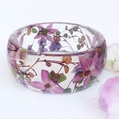 Stunning Handmade Resin Jewelry Showcases Exotic & Native Australian Flowers  Artist and owner of Ocean Petals Art Studio Jasenka decided to leave behind her professional career as a forestry and IT professional in 2005 when she transformed her passion for collecting flowers into a life-long artistic pursuit. She is an expert at identifying flowers and growing them beautifully.  In her home studio she preserves a garden with a wide range of flowers including Australian native flowers orchids…