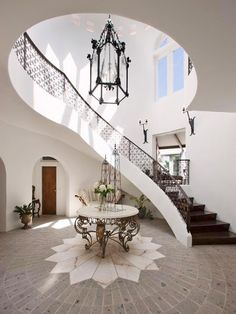 Suzie: Spanish style home with foyer, marble top foyer table, winding st. Suzie: Spanish style home with foyer, marble top foyer table, winding st… – Home Decor Mediterranean Style Homes, Spanish Style Homes, Mediterranean Architecture, Spanish Revival, Spanish Colonial, Morrocan Architecture, Spanish House Design, Spanish Style Bathrooms, Spanish Architecture