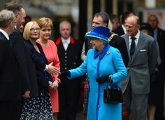 Queen Elizabeth II Photos - Queen Elizabeth II meets dignitaries at Waverley Station before boarding the steam locomotive 'Union of South Africa' on September 9, 2015 in Edinburgh, Scotland.  Today, Her Majesty Queen Elizabeth II becomes the longest reigning monarch in British history overtaking her great-great grandmother Queen Victoria's record by one day. The Queen has reigned for a total of 63 years and 217 days. Accompanied by her husband The Duke of Edinburgh, she has today opened the…