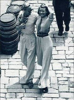 1930s high waisted, wide-legged trousers worn with wide belt, shirt and tie- Ingrid Bergman with Leslie Howard 1938 via Philip Bewley