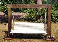 Backyard swing, made out of wood beams.