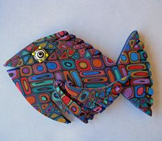 Ann Kruglak.  Large Art Magnet.  I consider myself an a-fishy-anado of all sea life.  Love snorkel and dive adventures.