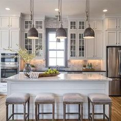 White and Gray Kitchen with Gray Window Trim Moldings More  Great Kitchen love the pendant lights, bar stools and pops if green. #pendants #kitchenisland #whitekitchen