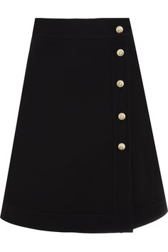 Gucci's A-line skirt is part of the Spring '17 collection. Neatly cut from a smooth wool and silk-blend, this mini style is embellished with faux pearl buttons detailed with burnished gold 'GG' emblems. Team yours with a pussy-bow blouse.