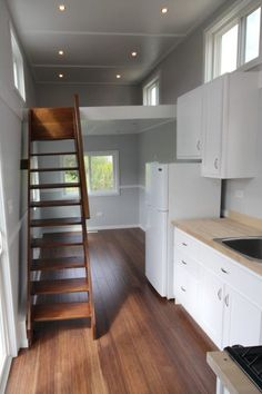 A king size master loft is accessed by open stairs and a twin bed loft is accessed by a ladder.