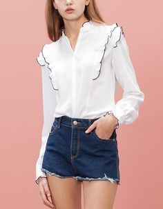 Shirt with shoulder frill trim.