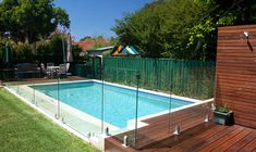 Glass safety fence around the pool to minimally obstruct sight lines.