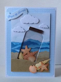 handmade card ... shore scene ... die cut cloudes ... acetate jar with shells inside ... sand and sea landsacape lines ... more shells ... luv it!