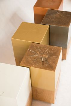 raw rough cut wood with high gloss finish side tables by lisa swanepoel