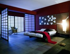 Shoji doors, low platform bed, warm red walls -