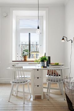 White dining room with Ikea 'Norden' table