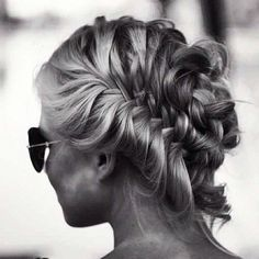 Messy french braid messy bun. Love it. Wish my fine straight hair would do it!!