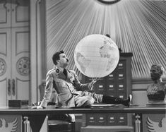 """Adenoid Hynkel (Charles Chaplin): """"Dictator of the world!"""" -- from The Great Dictator (1940) directed by Charles Chaplin"""