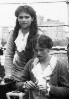 Grand Duchess Olga Nikolaevna knits and Grand Duchess Maria Nikolaevna stands behind her, 1910s. #Romanov