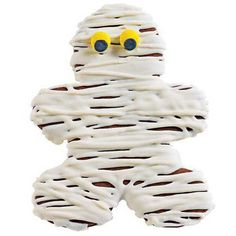 """A Chummy Mummy Cookie - If you're feeling lonely on Halloween, bake these Chummy Mummy cookies. Everyone, especially kids, will love to drizzle the yummy mummy """"wrapping"""" on these chocolate cookies."""