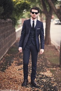 Blue three-piece suit.