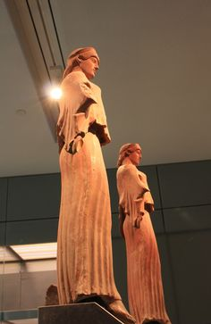 Statues at the entrance of the new museum , Athens, Greece / by philos from Athens