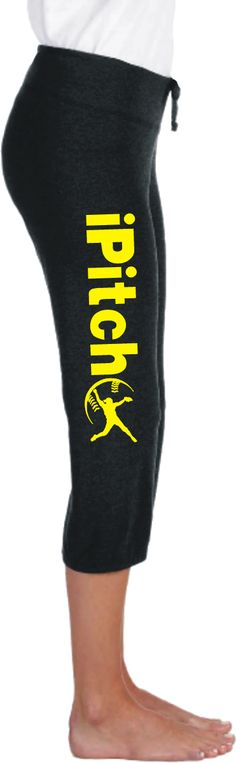 Fastpitch Softball iPitch Silhouette Leg Print Capri Scrunch Pant. From our softball player silhouette iSeries, this classic Bella Capri pant features yellow iPitch printed down the right leg with a softball pitcher silhouette nestled in softball seams. Printing on right leg so it reads upright while in sitting position.
