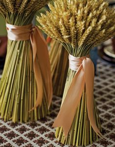 To craft the centerpiece of wheat sheaves, twist and secure wheat, purchased at a greenmarket or floral shop, with rubber bands, then wrap with a generous length of satin ribbon. Do a row across a fire place mantel?
