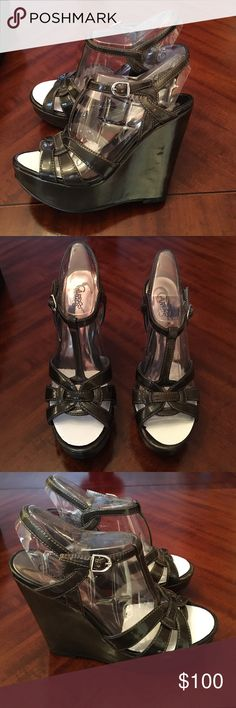 Vintage Carlos Santana wedge leather shoes new Brand new vintage Carlos Santana gunmetal grey patent leather wedge heels.. Size 7.5 women. Will match with anything nice color and high in detail. Come new in the box. These are in excellent new condition for its age. Came from a high end nyc apartment. Possibly 10-20 years old. Thanks. Carlos Santana Shoes Wedges