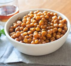 Dinner parties deserve snacks, too. And while dips and chips and veggie spreads are all fine and good, there's something quite wonderful about spicy roasted chickpeas.