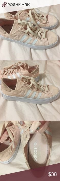 Adidas canvas sneakers Size 6.5 women's pink Adidas canvas sneakers in nearly perfect condition I only wore them once for about an hour. I paid 72 dollars for them brand new last year and they have just been sitting in my closet. These are a 6.5 but the fit runs a little bigger as they are just a tiny bit loose on my feet and I'm a 6.5 adidas Shoes Sneakers