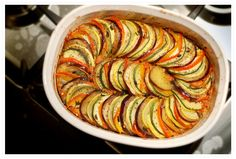 Ratatouille with zucchini, eggplant, tomato. If only I had a mandolin slicer...