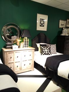 British Racing Green walls nicely contrast with the white and black graphic floors in HGTV by Bassett