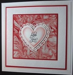 handcrafted Valentine ... shaving cream technique for background ... covered with micro beads ... white on white embossing on matting ... gorgeous!!