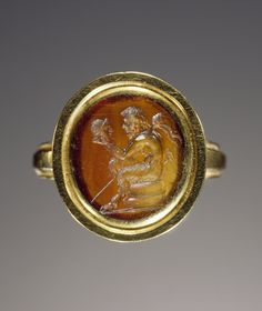 Engraved gem set into a ring. Artist/Maker(s): Unknown. Culture: Roman. Place(s): Roman Empire (Place created). Date: gem 1st century; ring modern. Medium: Carnelian set in modern gold ring.